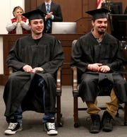 William Blake Reyer, left and Jeffery Lavender, right, were recognized during their graduation ceremony from the Murfreesboro Day Reporting Center on Monday, Feb. 24, 2020, at the Rutherford County Judicial Center. The program is run by the Tennessee Department of Correction.