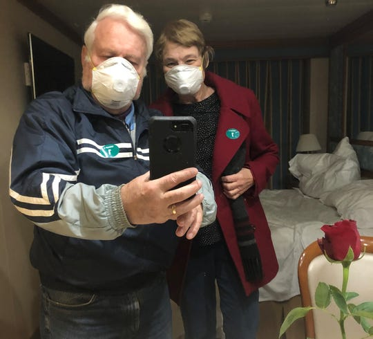 Dr. Arnold Hopland and his wife, Jeanie, take a selfie from quarantine on the Diamond Princess, a cruise ship in Japan that was paralyzed by an outbreak of coronavirus. Jeanie Hopland, who contracted the virus, is now being treated in a Japanese hospital. Arnold Hopland is still in quarantine.