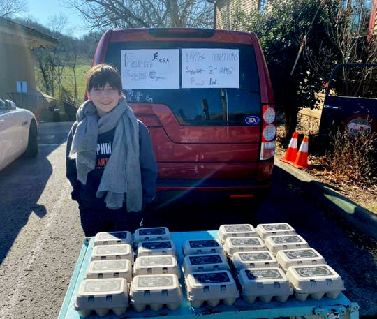 """Battle Ground Academy sixth grader Ozzy Coghlan set up an """"egg stand"""" outside Country Boy restaurant in Leiper's Fork and took donations for his family's organic farm fresh eggs to be given to the Ms. Cheap Penny Drive."""