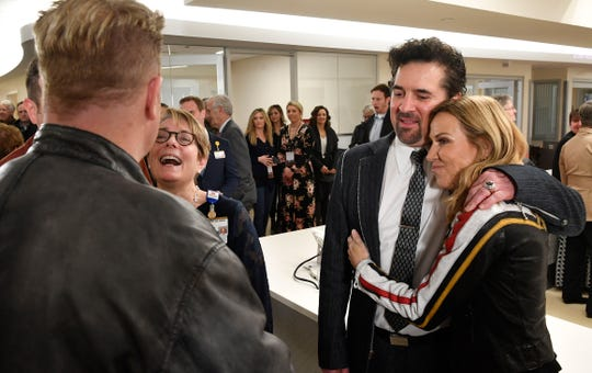 Meg Rush, MD, MMHC, President of Monroe Carell Jr. Children's Hospital at Vanderbilt talks with Gary LeVox of Rascal Flatts  as Big Machine Label Group founder/president/ceo Scott Borchetta gets a hug from Sheryl Crow after the ribbon cutting for a 23-bed Neonatal Intensive Care Unit (NICU) at Monroe Carrell Jr. Children's Hospital at Vanderbilt in Nashville, Tenn. Monday, Feb. 24, 2020.