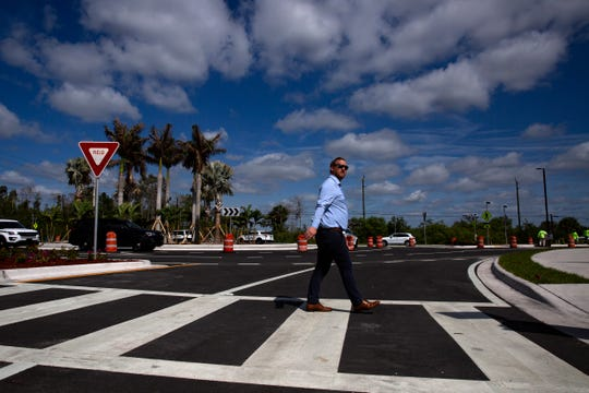 Landscape architect Ed Dean uses the new crosswalk along Logan Boulevard and Bonita Beach Road's roundabout on Monday, Feb. 24, 2020, in Bonita Springs.