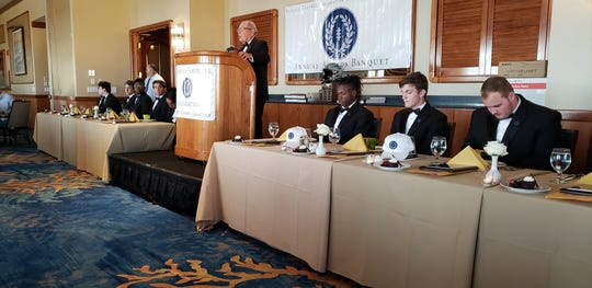 Chapter president Matt Sellitto addresses the crowd at the local National Football Foundation banquet surrounded by the high school senior scholarship winners. The Collier County chapter of the National Football Foundation held its third annual Scholar-Athlete Awards Dinner on Sunday, Feb. 23, 2020, at the Naples Sailing & Yacht Club.