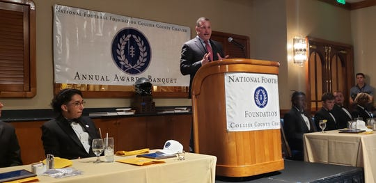 Dan Arment, CEO of helmet maker Riddell, speaks at the Collier County chapter of the National Football Foundation's third annual Scholar-Athlete Awards Dinner on Sunday, Feb. 23, 2020, at the Naples Sailing & Yacht Club. Arment received the chapter's Distinguished American Award.