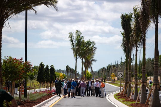 Community members gather along Logan Boulevard, in Bonita Springs for the new road's ribbon cutting ceremony on Monday, Feb. 24, 2020.