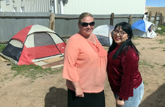 SPIN (Supporting People In Need) members Christie Wolford, executive director; and Vanessa Cruz, support services specialist; stand at Camp Silver in the back yard of Silver Linings Thrift Store and Resource Center. Silver Linings provides campers temporary housing with tents and bedding. SPIN is working with the homeless in Deming.