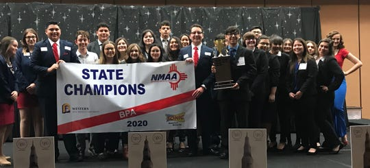 Carlsbad High School BPA members receive the State Championship banner.