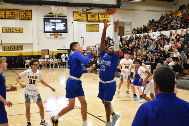 Shamar Smith grabs a rebound Friday night during a District 4-5A game in Tasker Arena in Hobbs. Smith led the Cavemen in scoring (22 points) while also grabbing 5 rebounds.