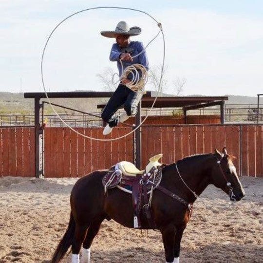 Daniel Castro demonstrates his talent with a horse and lasso.