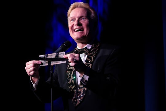 Director of entertainment and host, Jeff Hobson, performs at Marvyn's Magic Theater on Sunday, Feb. 23, 2020 in La Quinta, Calif.
