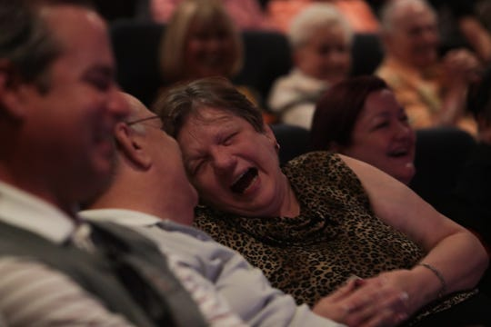 Crowd-members laugh while watching Robbie Howard at Marvyn's Magic Theater on Sunday, Feb. 23, 2020 in La Quinta, Calif.