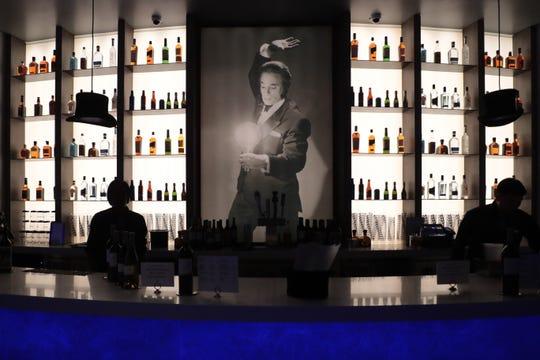 Bartenders work at Marvyn's Magic Theater on Sunday, Feb. 23, 2020 in La Quinta, Calif.