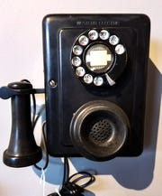 In the 1920s, wood was replaced with Bakelite as the phone material of choice.
