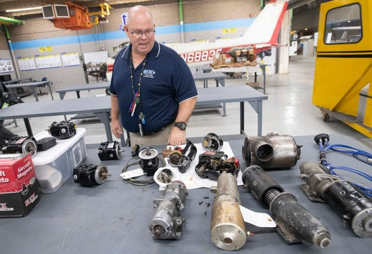Cliff Vonada, aviation maintenance coordinator at George Stone Technical College, looks over some of the work completed by students in the program on Monday.