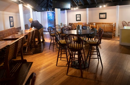 An employee of Kingfisher Craft Sandwich and More prepares for the dinner crowd on Feb. 13. Kingfisher has garnered a loyal following after its opening in the former Slips restaurant building on Barrancas Avenue.