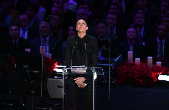 WNBA star Diana Taurasi looks skyward while delivering her speech during the memorial to celebrate the life of Kobe Bryant and daughter Gianna Bryant at Staples Center.