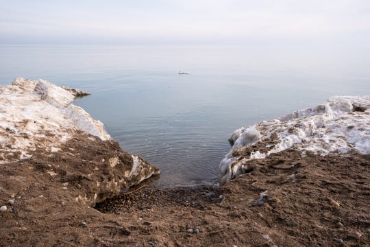 Ice, snow and dirt cover the shoreline along Lake Huron at Fort Gratiot County Park Monday, Feb. 24, 2020. State-permitted jetties were installed at the park several years ago to protect against erosion affecting buildings, but not the beach itself.