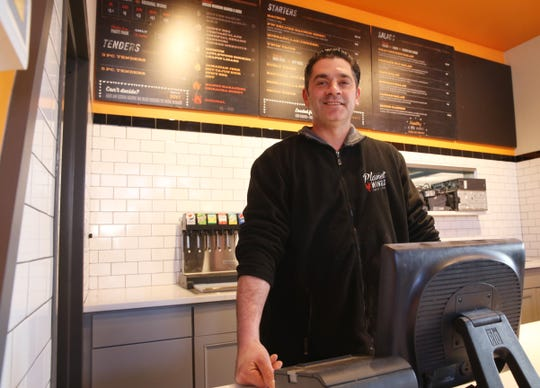 Pizza E Birra and Planet Wings owner Danny Petrizzo behind the register at their Town of Poughkeepsie restaurant on February 19, 2020.