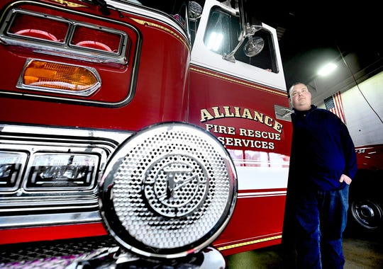Alliance Fire and Rescue Services Deputy Chief Ben Rodkey poses, Monday, Feb. 24, 2020, with the newly emblemed Truck 77, at the Red Lion station. Alliance is the result of the merger of the former Red Lion and Felton borough fire companies. The Red Lion station serves as the new company's main station. Bill Kalina photo