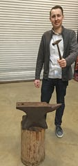 Erik Shinn strikes the anvil that will be featured as part of the York Symphony Orchestra's March 14 concert.