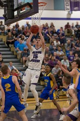 Spanish Springs guard Mason Whittaker (15) shoots over the Reed defense during the first half of the class 4A Northern Regional Boys Basketball Championship game at Spanish Springs High School in Sparks
