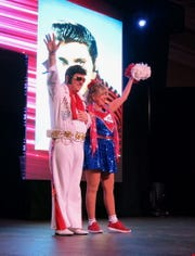 Ambassadeurs Duke and Duchess of Prosperity Keith Keen, as Elvis Presley, and Patricia Schwartz, as a cheerleader.