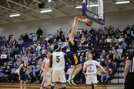 Augustana's Dylan LeBrun throws down a dunk in last Friday's win over USF. Both teams begin NSIC tournament play on Wednesday.