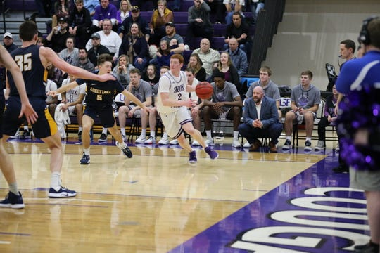 Jack Thompson (2) and coach Chris Johnson (right) have done their part to guide USF to 21 wins and the NSIC South title this year.