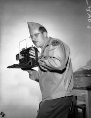 Associated Press staff photographer Joe Rosenthal is pictured in San Francisco prior to this departure for Honolulu for pool assignment with the Pacific fleet, March 25, 1944.