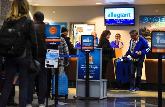 Passengers check in for the first Allegiant flight to Punta Gorda, Florida, in November 2017 at St. Cloud Regional Airport.