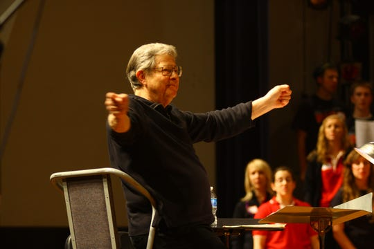 Conductor Dale Warland leads the choir atthe 2012 Big Sing festival.