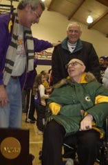 UW-Stevens Point basketball coach Jack Bennett. left, greets Don Friday (in wheelchair) during a rally on campus after the Pointers basketball team won the NCAA Division III championship in 2004.