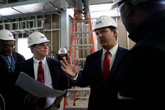 Gov. Ron DeSantis chats with other lawmakers during a tour of Florida A&M University's new Center for Access and Student Success which is currently under construction Monday, Feb. 24, 2020.