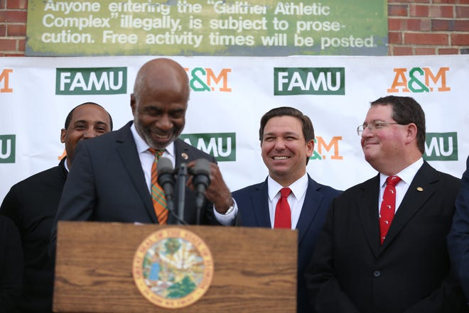Gov. Ron DeSantis laughs at a joke from Florida A&M University President Larry Robinson during a dedication ceremony for the school's new Center for Access and Student Success which is currently under construction Monday, Feb. 24, 2020.