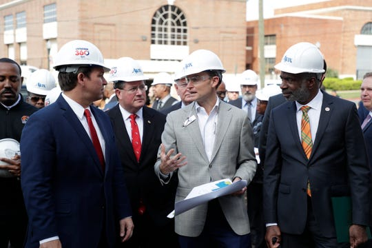 Ajax Building Company Vice President Jay Smith gives Gov. Ron DeSantis and Florida A&M University President Larry Robinson information on the construction of FAMU's new Center for Access and Student Success which is currently under construction Monday, Feb. 24, 2020.