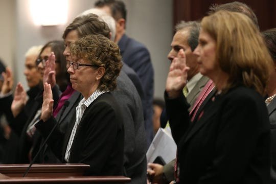 Members of the Florida Coalition Against Domestic Violence (FCADV) board swear an oath before being sequestered during a meeting of the Florida House Public Integrity & Ethics Committee where board members were publicly interviewed as part of an investigation into their mismanagement Monday, Feb. 24, 2020.