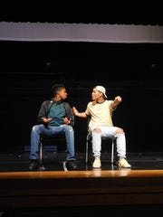 """Chokwe Bennett, right, and castmate rehearse a scene in """"Hold On, It's Just the Middle."""""""