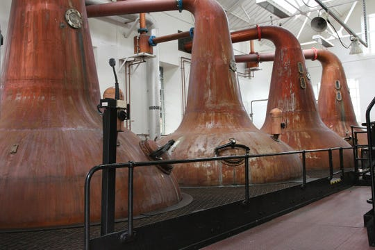 An inside view of stills at a commercial distiller.