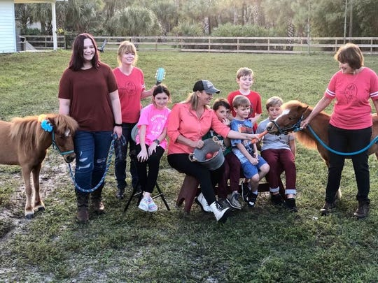 Kristi Huddleston (center) is the founder of Harmony Hope Stables equine and music therapy program.