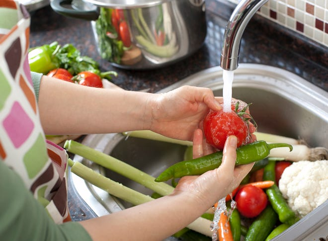 Washing vegetables is a way of preventing food-borne illness.