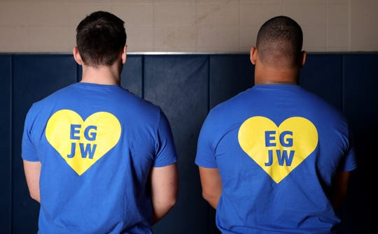 Ardsley wrestling heavyweights Billy Fon, left, and George Lebberes, wearing shirts in memory of their friends, Eric Goldberg and Jordan Wachtell, that died in a horrific crash.