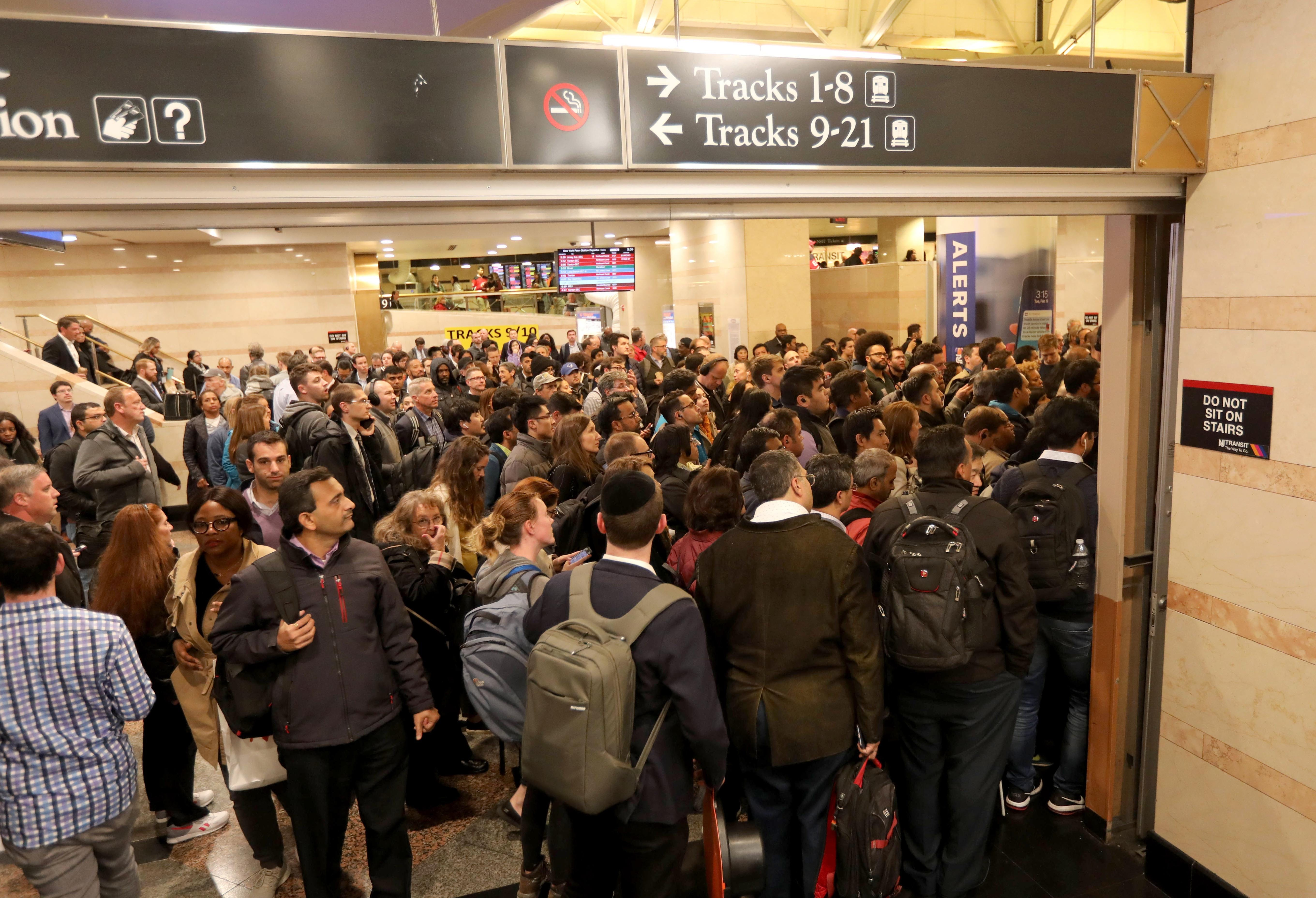 Thousands of commuters make their way towards trains at Penn Station during the evening commute Oct. 17, 2019. After crowding under train schedule boards waiting for gate locations to be posted, commuters rush to their gates, with sometimes only minutes to spare before their train leaves the station.