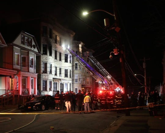Firefighters are shown at the scene of a four-alarm blaze at 112 Saratoga Avenue in Yonkers on Sunday, Feb. 23, 2020.