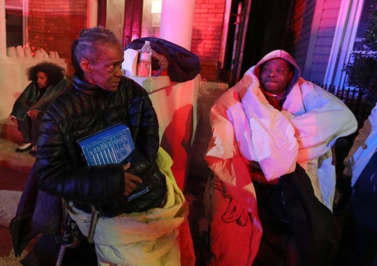 Loretta Carlisle and Timothy Bertrand, residents of 112 Saratoga Ave. in Yonkers, sit across the street from the apartment building as firefighters battled a four-alarm fire in the building Feb. 23, 2020. One person was killed in the fire. The Red Cross and Yonkers Office of Emergency Management were assisting at least eight families who lived in the building.