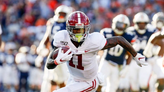 Alabama wide receiver Henry Ruggs III (11) caries the ball against Auburn during an NCAA college football game Saturday, Nov. 30, 2019, in Auburn, Ala.
