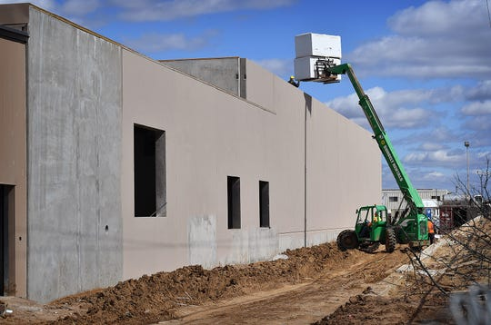 Roofing insulation is lifted up as construction progresses on the $70 million Wichita County Law Enforcement Center Monday.
