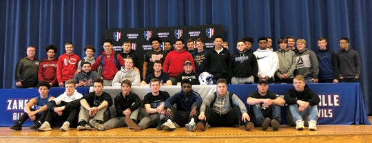 The Zanesville football team is pictured with three players who signed to play college football on Monday. They are Brian Ulbrich, Ben Everson and Ryan Tompkins, who are seated in the center.