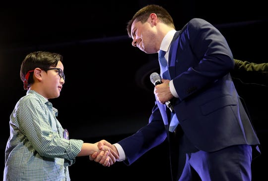 Democratic presidential candidate Pete Buttigieg greets Zachary Ro, who asked Buttigieg to help him tell others he is gay, while the candidate was speaking at a town hall campaign event at the Denver Airport Convention Center February 22, 2020.