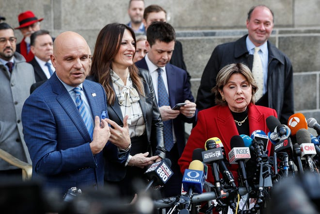 Gloria Allred, right, at press conference after the verdict in Harvey Weinstein's sex-crimes trial. His attorneys, Arthur Aidala, left, Donna Rotunno and Damon Cheronis, wait to speak outside the courthouse, Feb. 24, 2020, in New York.
