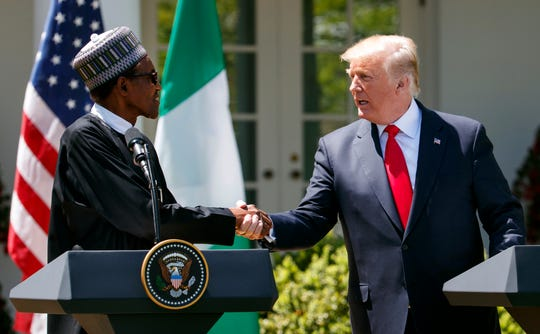 President Donald Trump shakes hands with Nigerian President Muhammadu Buhari during a news conference in the Rose Garden of the White House in Washington, Monday, April 30, 2018.
