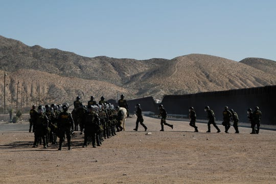 Border Patrol agents in New Mexico train to respond to hostile crowds throwing rocks at a border fence on the U.S.-Mexican border.